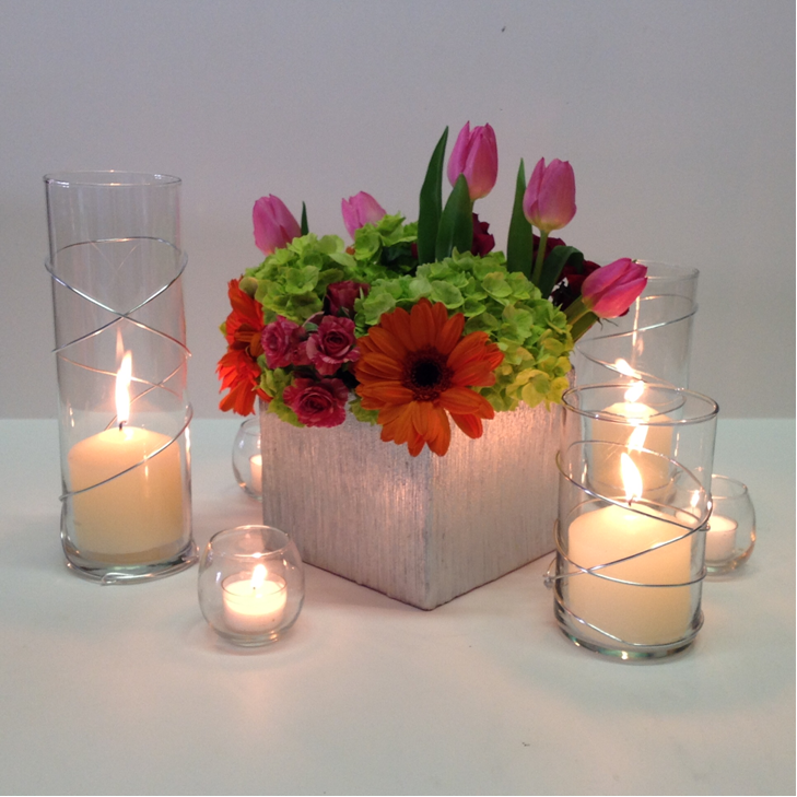 Spring floral centerpiece with candles in wire wrapped
